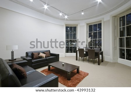 stunning luxury living room with massive bay window - stock photo