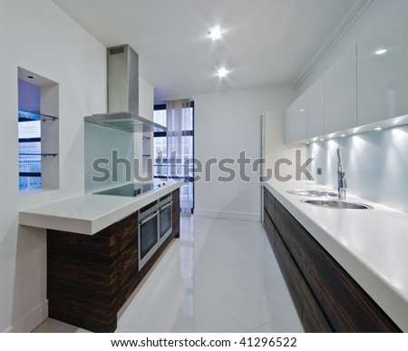 stunning luxury modern kitchen of a top floor penthouse apartment - stock photo