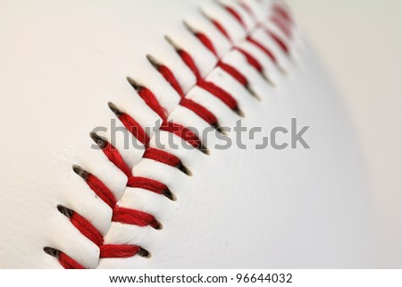 Stunning macro of the threads of a baseball. - stock photo