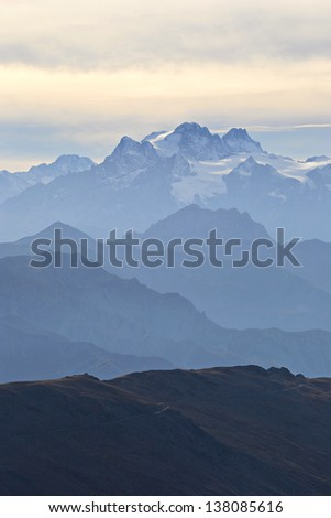 Stunning panorama high in the italian Alps on an extreme rocky landscape, with mejstic view on the high peaks of the Ecrins Massif National Park, France. - stock photo