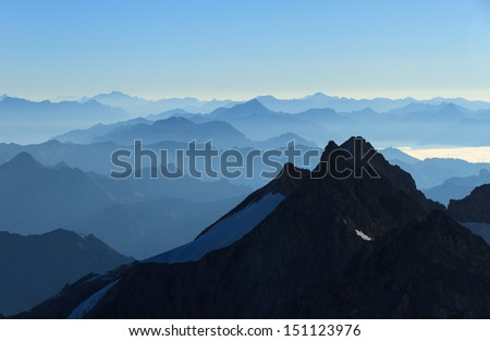 Stunning panorama  in the Alps with a majestic view on the high peaks of the  Ã?Â?crins Massif National Park, France.  - stock photo