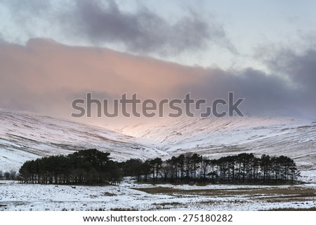 Stunning pink sunrise over mountain Winter landscape  - stock photo