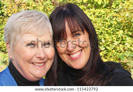 Stunning portrait of a beautiful elderly mother and her daughter