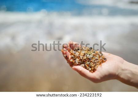 Stunning sand of glass beach near Port Allen town on Kauai, Hawaii - stock photo