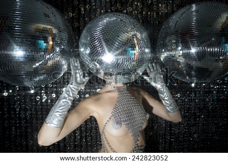 stunning sexy disco woman with a mirror ball for a head - stock photo