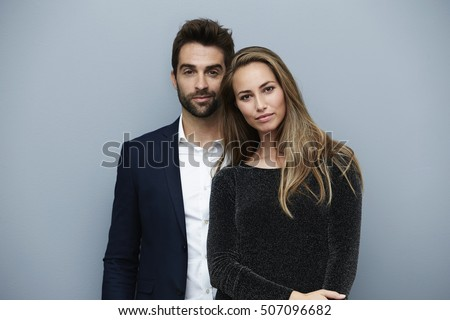 Stunning smartly dressed couple, portrait