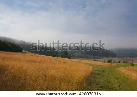 Stunning spring landscape in the morning mist - stock photo