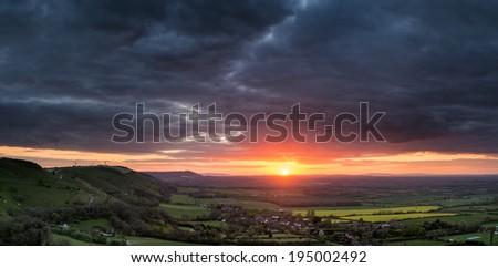 Stunning Summer sunset across countryside escarpment landscape - stock photo