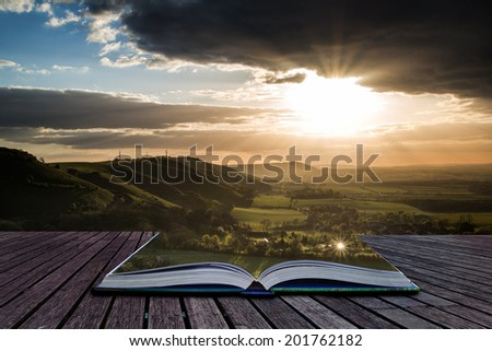 Stunning Summer sunset across countryside escarpment landscape Creative concept  - stock photo