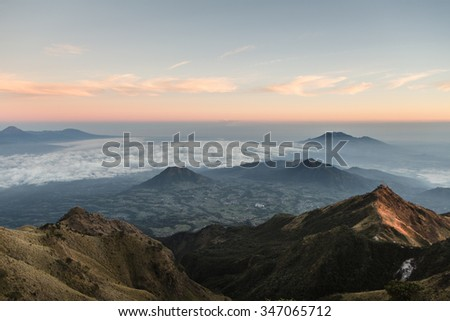 Stunning sunrise over the countryside around Yogyakarta in central Java in Indonesia from the top of the Merbabu volcano.