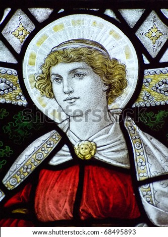 Stunning 15th Century stained glass window detail with vibrant colors and excellent detail of Hope - stock photo