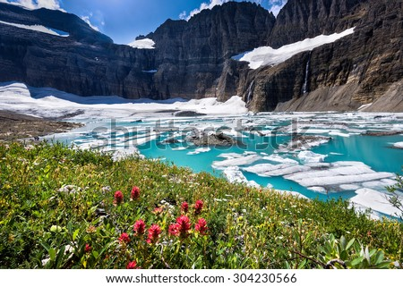 Stunning turquoise colored water at the base of Grinnell Glacier in Glacier National Park, Montana - stock photo