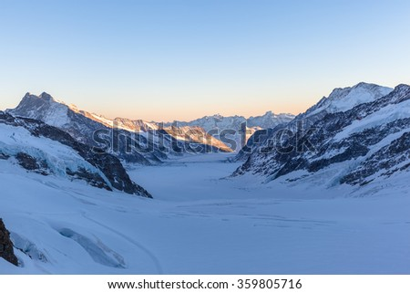 Stunning view of Aletsch glacier from the view platform on Jungfraujoch at twilight in winter, the highest railway station of Europe on Bernese Oberland, Switzerland. - stock photo