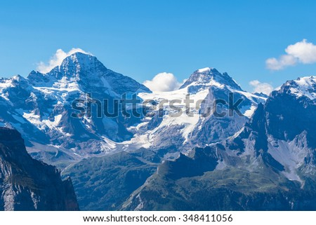 Stunning view of Breithorn and the Alps on Bernese Oberland and the Lauterbrunnen valley from Mannlichen station, Switzerland. - stock photo
