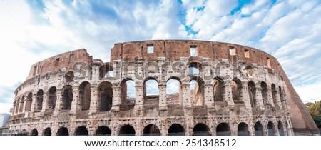 Stunning view of Colosseum in Rome against blue sky. - stock photo