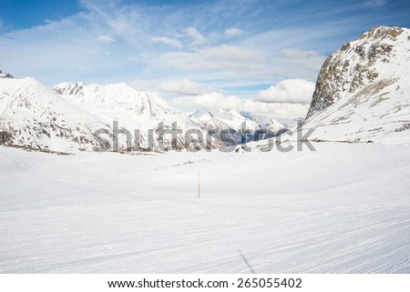 Stunning view of high mountain peaks in the italian alpine arc, in a bright sunny day. Ski resort of La Thuile and La Rosiere, on the border Italy France. Mont Blanc summit (4810 m) at the horizon. - stock photo