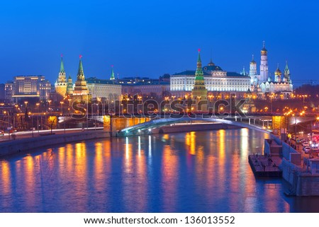 Stunning view of Moscow Kremlin with car traces in the night, Russia