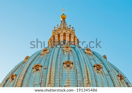 stunning view of Saint Peter's Basilica Dome in Vatican City, Italy (picture taken at sunset) - stock photo
