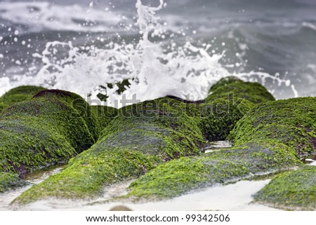 stunning view of surf on green rock at beach in spring,Taiwan - stock photo