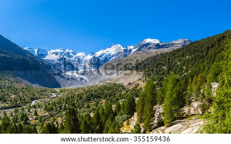Stunning view of the Bernina massive and Morteratsch glacier on the hiking path in Engadine area of Switzerland. - stock photo