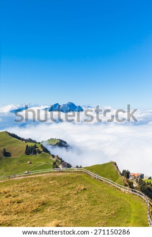 Stunning view of the Pilatus above the clouds from top of Rigi mountain, Lucerne, Switzerland - stock photo