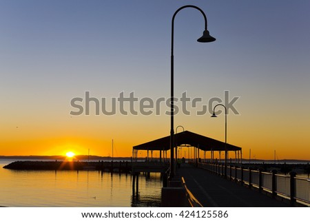 Stunning view of the Redcliffe, Australia, jetty at sunrise - stock photo