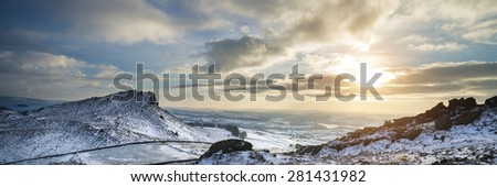 Stunning Winter panorama landscape snow covered countryside with beautiful sky and clouds