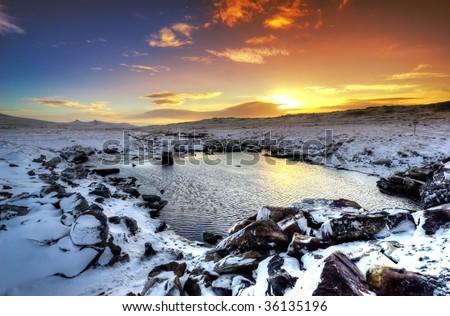 Stunning winter sunset in the Falkland Islands - stock photo