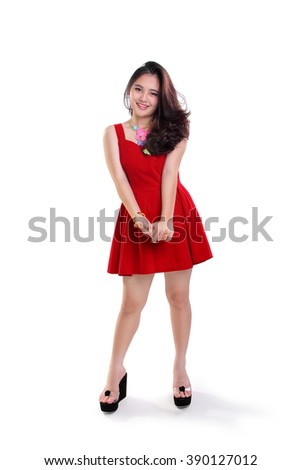 Stunning young Asian woman posing in casual red dress, full length portrait isolated on white background - stock photo
