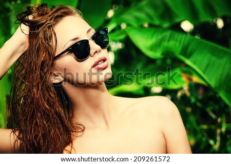 Stunning young woman in bikini in the rainforest. Vacation. Tropics. - stock photo