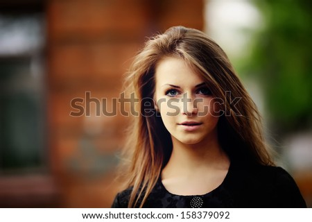 Stunning young woman portrait outside. Street fashion.