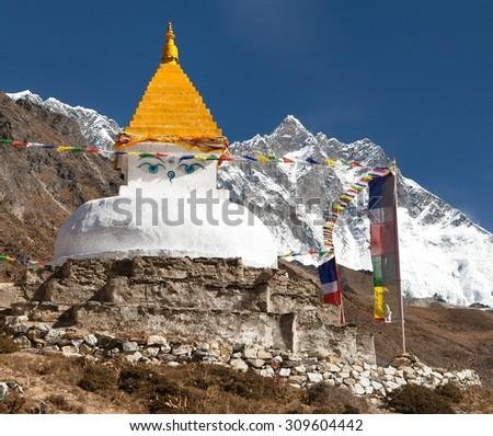 Stupa and prayer flags near Dingboche village with mount Lhotse, way to Everest base camp, Khumbu valley, Solukhumbu, Sagarmatha national park, Nepalese himalayas - stock photo
