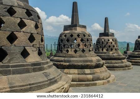 Stupa's at Borobudur temple in Yogyakarta, Indonesia - stock photo