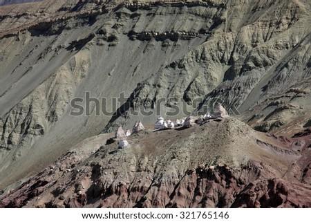 Stupas in the Himalayas (Buddhistic symbol) - Ladakh - stock photo
