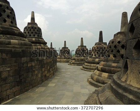 stupas in the ninth century mahayana buddhist temple of borobodur,  in magelang, java, indonesia