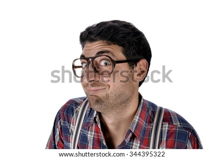 stupid face of young nerd with glasses - stock photo