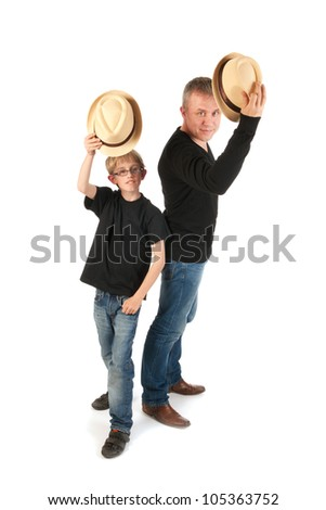 Sturdy father and son with hats making performance - stock photo