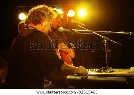 """STUTTGART - AUGUST 04: Group """"Eric Prinzinger """" in concert at summer Festival Stuttgart August 04, 2011 in Stuttgart, Germany. - stock photo"""
