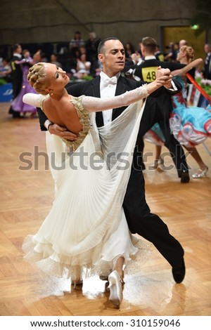 Stuttgart, Germany - August 11, 2015: An unidentified dance couple in a dance pose during Grand Slam Standart at German Open Championship, on August 11, in Stuttgart, Germany