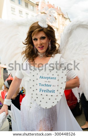 STUTTGART, GERMANY - JULY 25, 2015: A handsome man dressed as woman is presenting the motto of the Christopher Street Day 2015 in Stuttgart: Acceptance is the daughter of Liberty.  - stock photo