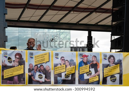 STUTTGART, GERMANY - JULY 25, 2015: Fritz Kuhn,  Lord Mayor of Stuttgart and patron of the Christopher Street Day 2015 in Stuttgart is having a speech as final of the political parade.  The - stock photo