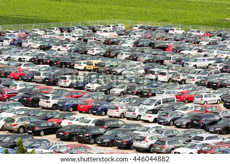 Stuttgart, Germany - June 25, 2016: Hundreds of cars parked in a large parking lot at the airport in Stuttgart, Germany. The airport offers various carparks for different prices, this one storey open - stock photo