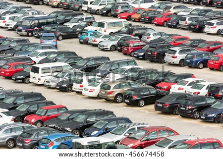 Stuttgart, Germany - June 25, 2016: Hundreds of cars parked in a large parking lot at the airport in Stuttgart, Germany with one car about to park. The airport offers various carparks for different