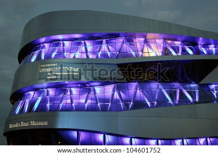 """STUTTGART, GERMANY - JUNE 2: Light Show at the Mercedes Benz Museum-Building at the festival """"Intel Ultrabook 3D Tour """" June 2, 2012 in Stuttgart, Germany - stock photo"""