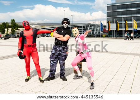Stuttgart, Germany - June 25, 2016: Three cosplayers are posing during the Comic Con Germany event in Stuttgart in front of the exhibition hall on public ground.  - stock photo