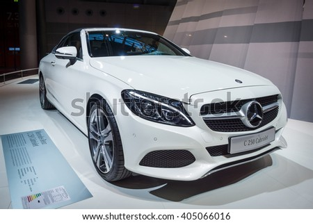 "STUTTGART, GERMANY - MARCH 17, 2016: Compact executive car Mercedes-Benz C250 Cabriolet (W205), 2016. Europe's greatest classic car exhibition ""RETRO CLASSICS"" - stock photo"