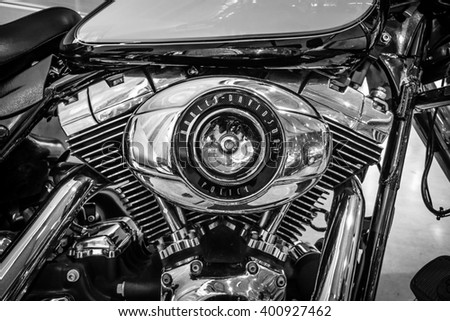 """STUTTGART, GERMANY - MARCH 17, 2016: Engine of motorcycle Harley-Davidson FLHP Police, 2008. Black and white. Europe's greatest classic car exhibition """"RETRO CLASSICS"""" - stock photo"""