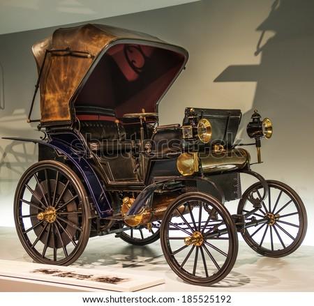 """STUTTGART, GERMANY - MARCH 30, 2014: Museum """"Mercedes-Benz Welt"""". Daimler motorized wheelchair viz-a-vie - 1896 - stock photo"""