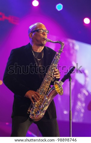 "STUTTGART, GERMANY - MARCH 24:  Saxophonist of the group ""Chubby Checker"" live in concert on stage at the festival March 24, 2012 in Stuttgart, Germany - stock photo"
