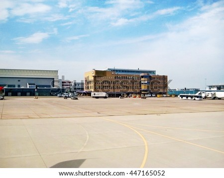 Stuttgart, Germany - May 26, 2008: Terminal labeled with Stuttfart at Airport Echterdingen - view from inside of airplane, runway in front
